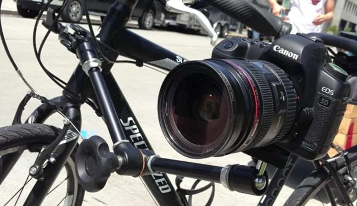carrying-camera-on-a-bike